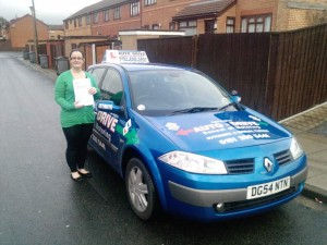 Alison past her test with Auto Drive and showing off her certificate